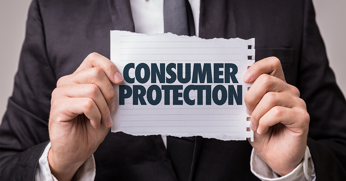 man holding consumer protection sign