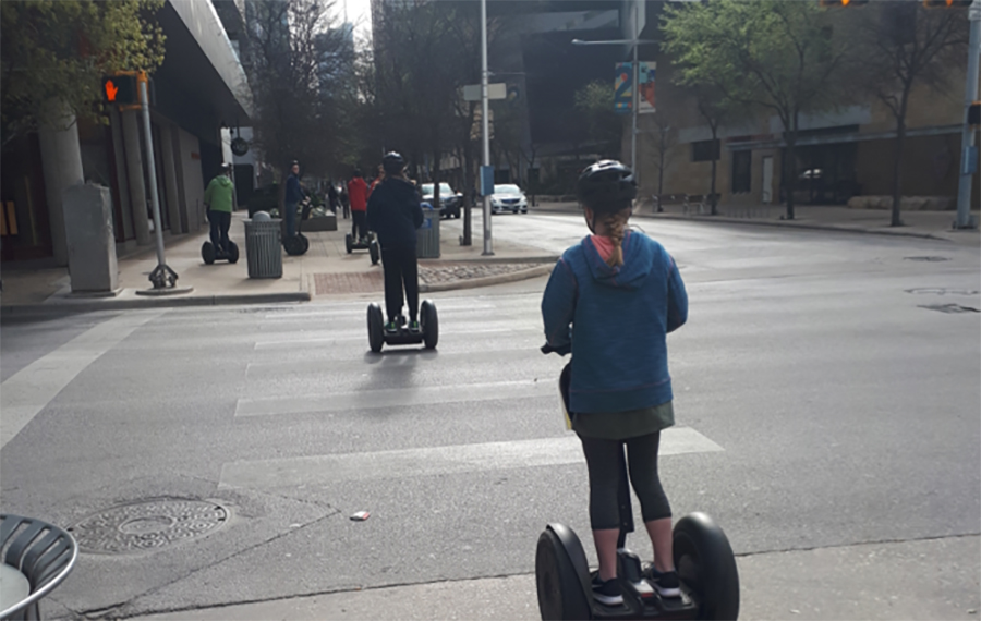 SXSW people on scooters