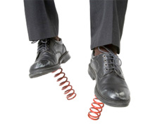 A man wearing shoes with springs attached to soles