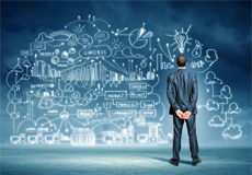 A man looking at a business strategy map