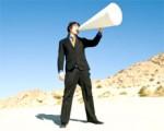A man using a white megaphone