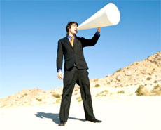 A man using a white megaphone