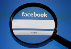 Facebook log in page and a magnifying glass