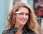 A woman wearing Google glass and a black jacket
