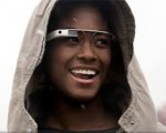A woman wearing a hoodie and google glass
