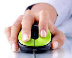 A person using a green mouse