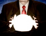 A man wearing a suit using a crystal ball