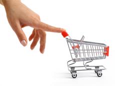 A finger pushing a shopping cart