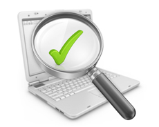 Laptop, a magnifying glass and a green check mark