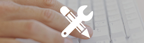 Hand on keyboard with tool and pencil icon. API ecommerce allows you to create new business opportunities.